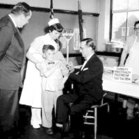 Dr. Frank Mirabello administers the new polio vaccine