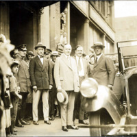 President Calvin Coolidge in front of entrance to security trust building, Willow Street, Lynn, August, 1925