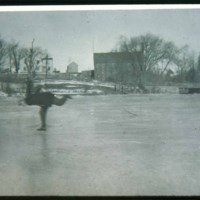 Saugus Center, Percy Cutter skating on Saugus river, Scott mill in back