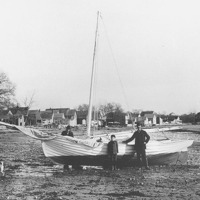 Benjamin Martin and son with sailboat on Blaney Beach