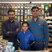 Owners of the store on the corner of Hermon Street and Pauline Street.  (and son)